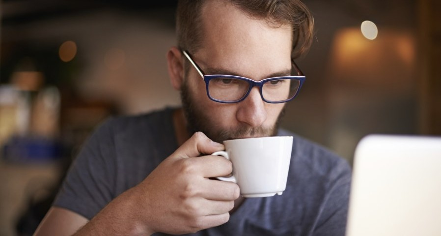 Man drinking coffee 898x480