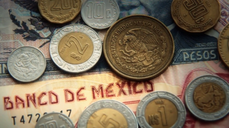Mexican pesos 2 mexican paper money and metal coin currency blurred and goes into focus slowly v1pv woc  f0009